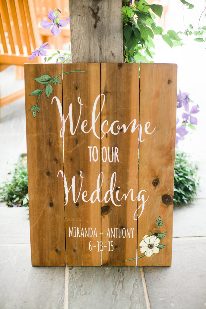 Welcome guests calligraphic wooden sign 56f47