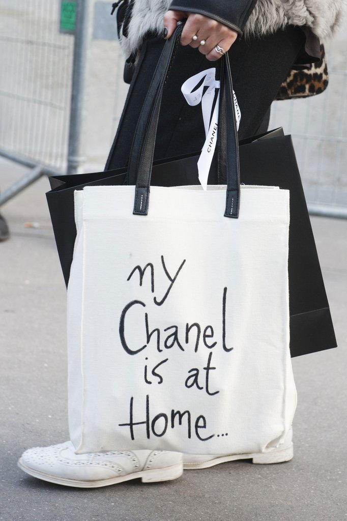 black white tote displayed cheeky chanel message