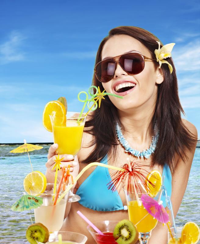 girl in bikini on beach drinking cocktail 1