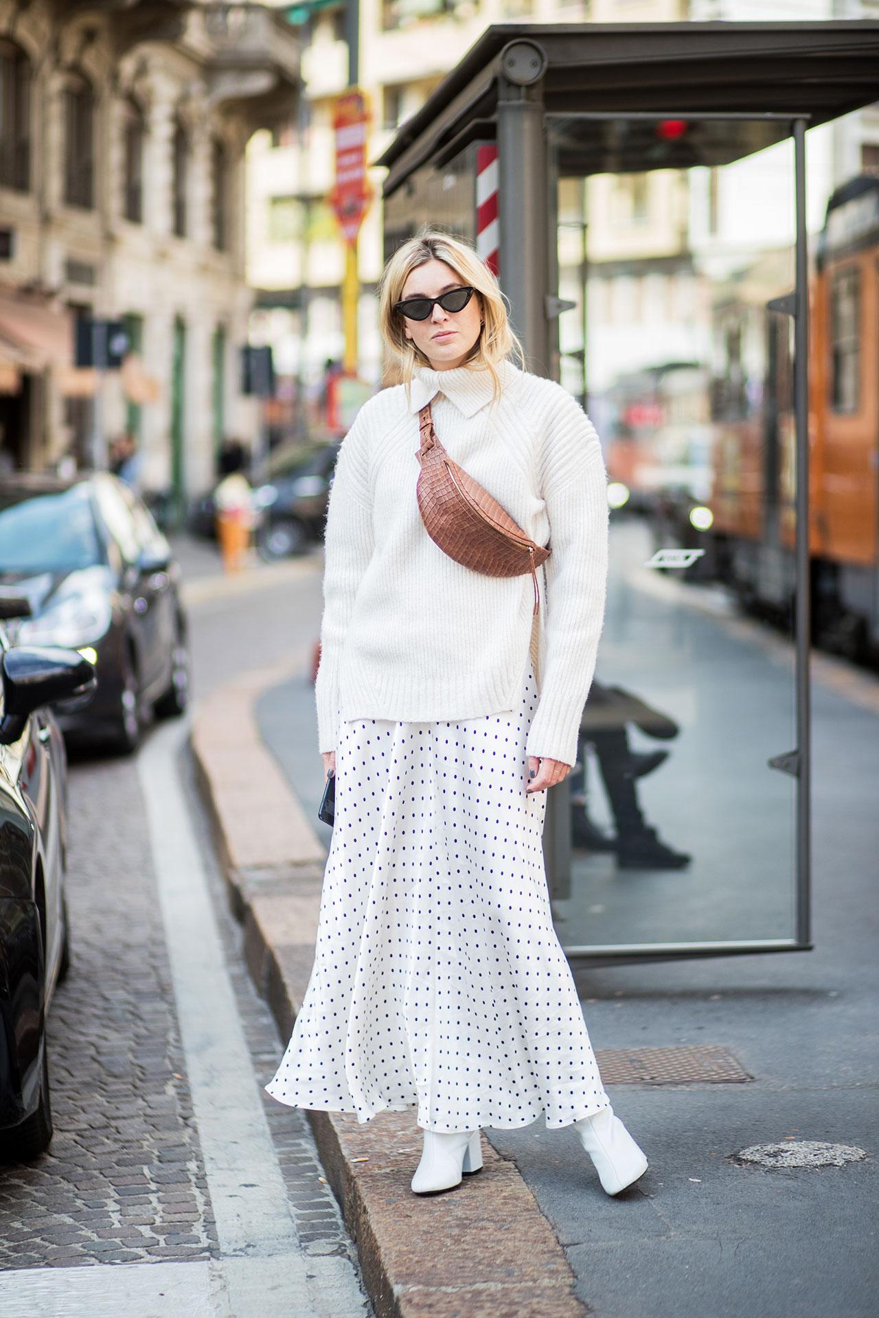milan fashion week street style spring 2018 camille charriere white sweater white polka dot ganni dress white boots fanny pack belt bag