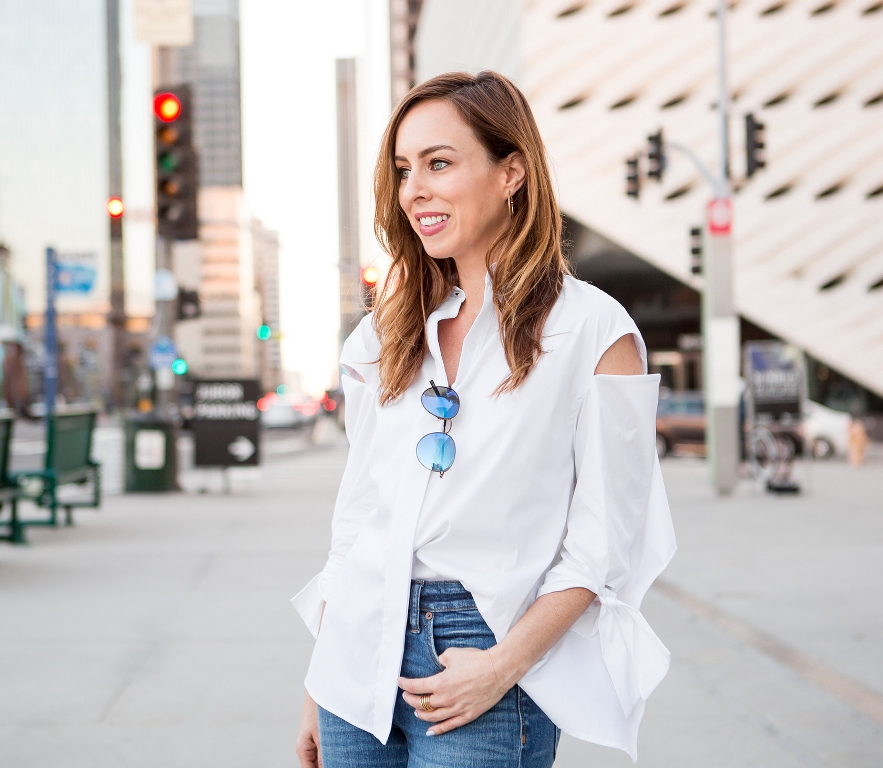 Sydne Style shows how to half tuck a button down shirt with jeans
